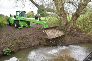 Placing gravel in the brook