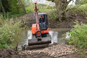 Digger in the brook
